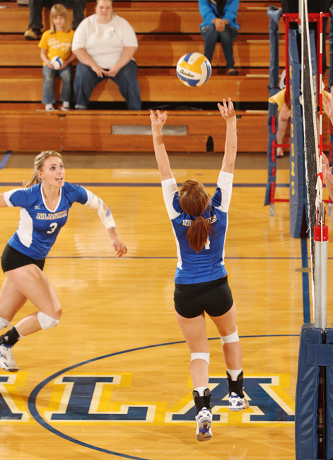 Nannook volleyball player Becky Martin sets the ball to Jaxon Hill