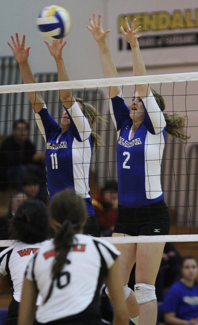 Nanook volleyball players Morgan Tebbs and Karlee Skalla block a hit
