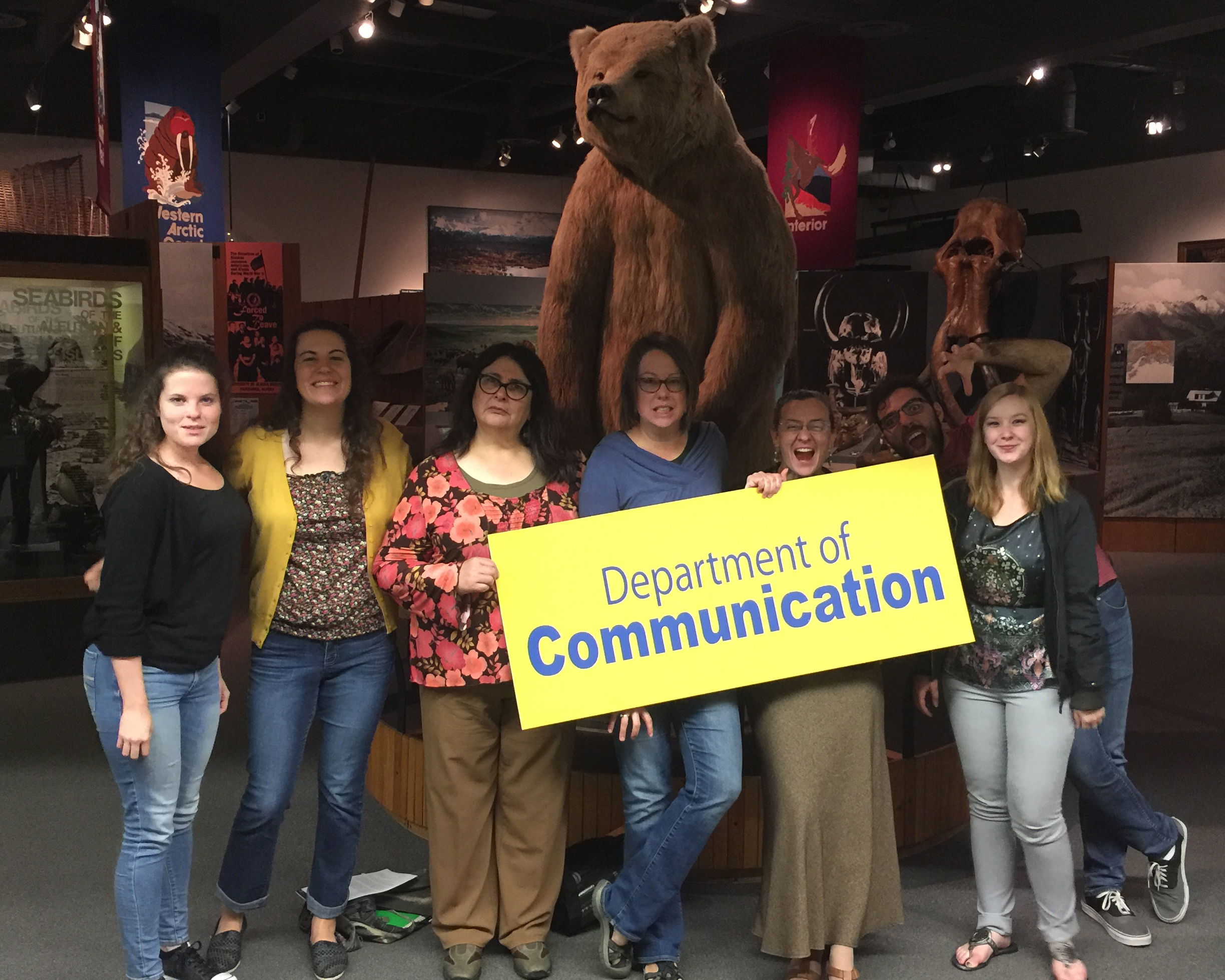 Communication Graduates and Adjuncts pose with Dr. Taylor at the UA Museum of the North.