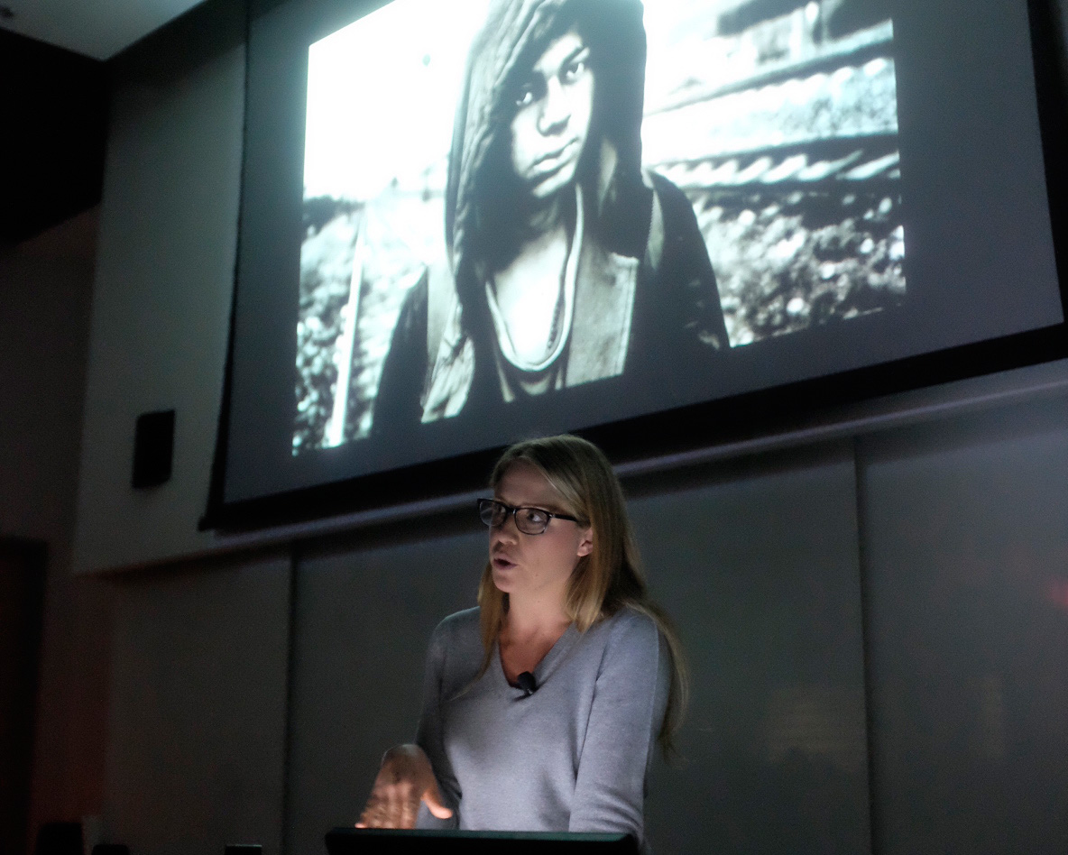 Katie Orlinsky , 2018 Snedden Chair of Journalism at #uafcojo discusses her photojournalism career during a public lecture..