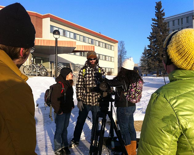 Journalism students Lindsey Von Borstel, Sophia Holton and John Hall field reporting at -20F.